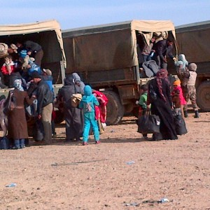 8-Helping-Syrian-refugees-board-Canadian-trucks-Jordanian-border21